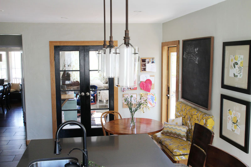 Kitchen Breakfast Table | Tufted Bench, Giant Chalkboard, Black French Doors | PepperDesignBlog.com