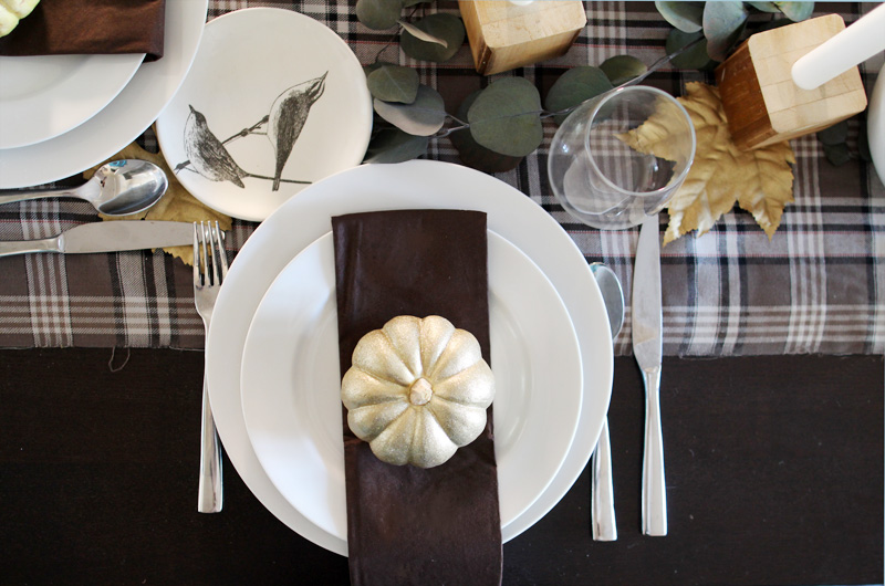 Plaid Thanksgiving Table | Wooden Bedpost Candlesticks, Glitter Gold Pumpkins, Brown, Black, Tan Plaid Tablescape | PepperDesignBlog.com