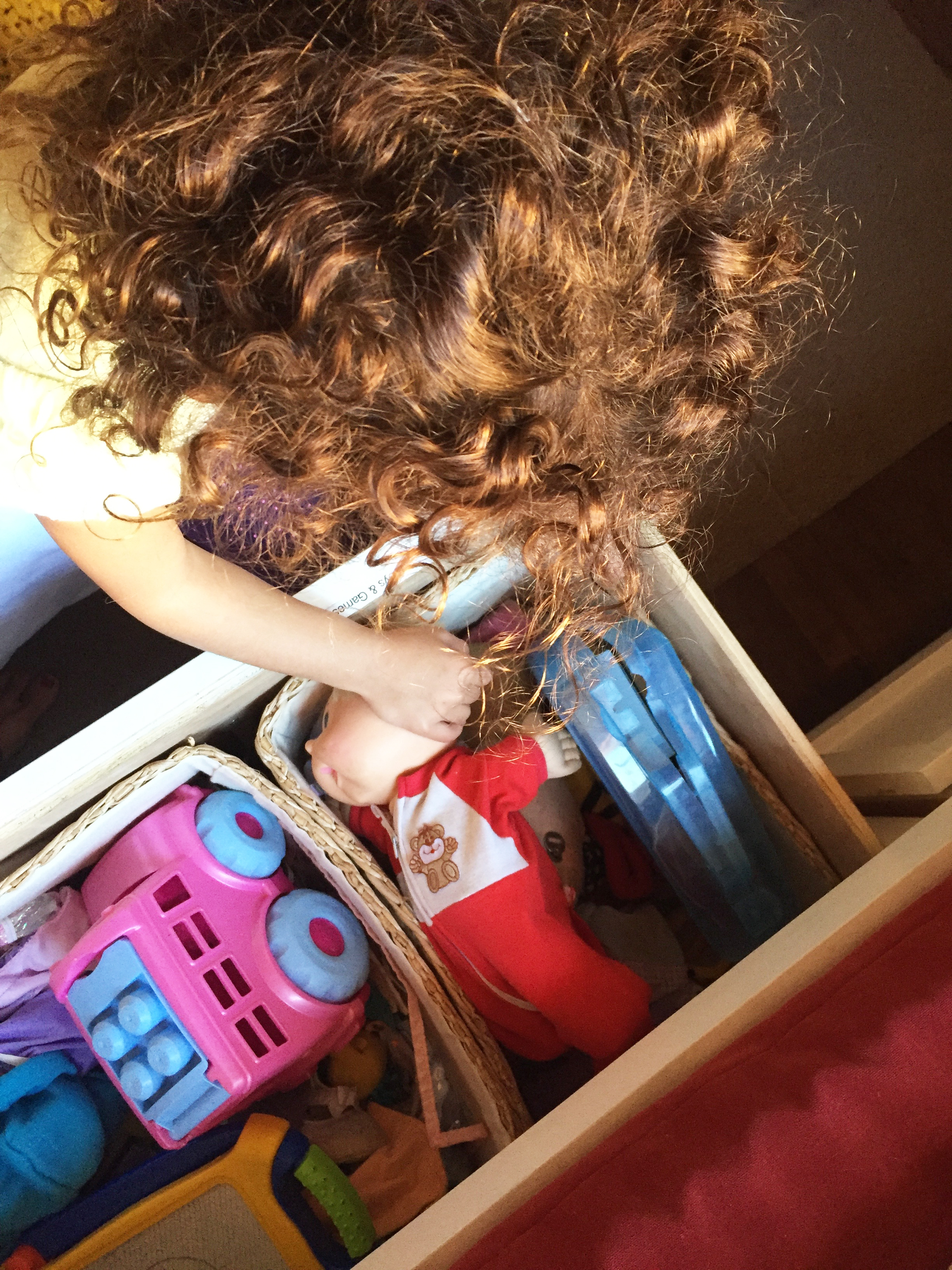 Glad to Give - Liv Sorting Toys in Girls' Room