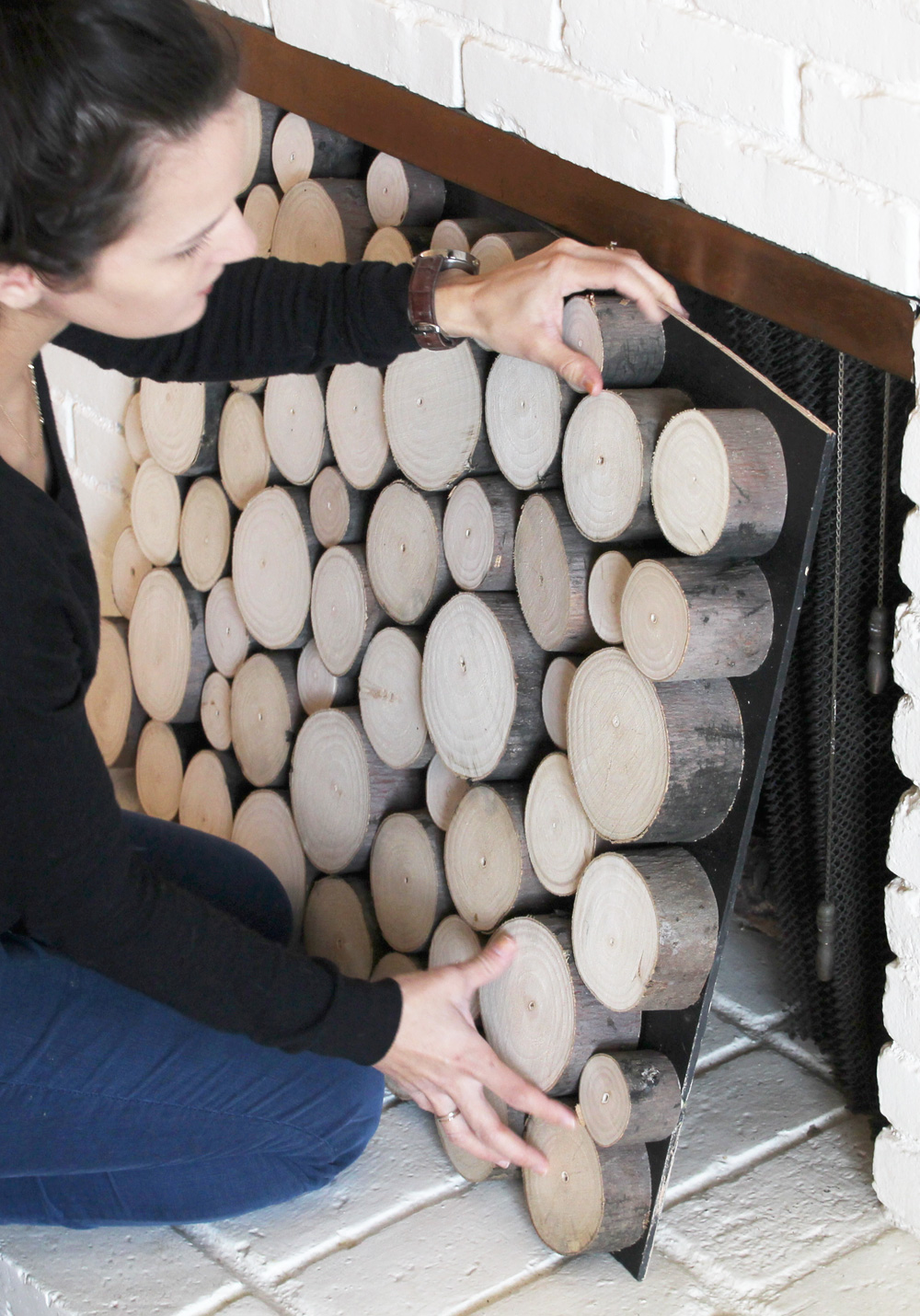 faux log stack door for a fireplace